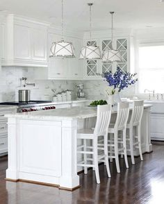 Love the light fixtures in this white kitchen