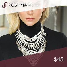 "Glam Rock Bohemian Silver Rhinestone Bib Necklace Gorgeous Bib Style Rhinestone Necklace is the perfect statement accessory. Rhinestones are high-shine.  Weight: 0.28 lbs Color: Silver Measurement Length: 15"", Drop: 3"", Adjustable Up To: 19"" J. Moda Collection Jewelry Necklaces"