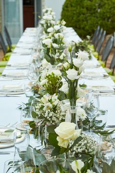White centerpiece for long table. Wedding in italy.