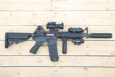 Systema Training weapon M4 CQB-R. Airsoft gun in Japan. Fashion Photo.   Silencer - Knight's Armament