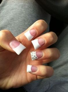 Flare nails. Beautiful. Simple bt still enough. White tips with rhinestone accents