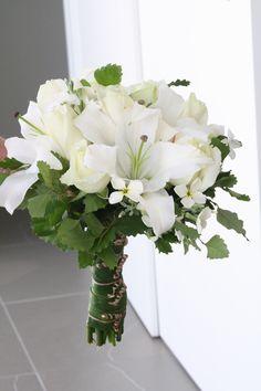 Lilies, roses, native foliage. www.wanakaweddingflowers.co.nz/gallery.php