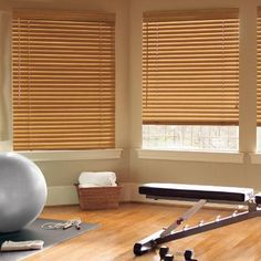 "Levolor 2"" Classic Wood Blinds in Sunset Oak. This collection provides the natural beauty of wood at an affordable price. Choose the Lightmaster option to eliminate holes in slats and block more light. Find them at Blinds.com."