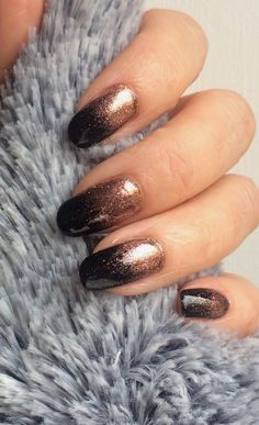Black gelish with rose gold glitter by The Beautiful Nails Company….