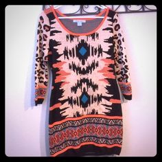Flying Tomato Aztec Print Sweater Dress/Top Beautiful sweater dress! The size listed is Large, however, it is closer to a size 8 or a Medium. Flying Tomato Dresses