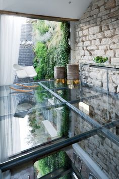 Glass Floor, Stone Wall, Stylish Two-Floor Apartment in Paris, France