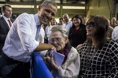 President Barack Obama is kissed by 94-year-old Carolina Garcia Delfin, a Filipina nurse who fought in the resistance against Japanese force...