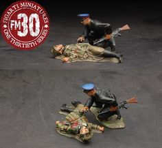 World War II Russian Army EFR-017 Russian Soldier & Dead German - Made by Figarti Military Miniatures and Models. Factory made, hand assembled, painted and boxed in a padded decorative box. Excellent gift for the enthusiast.