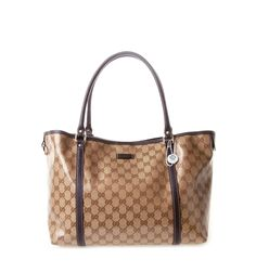 49c5977ee11 Give your daywear look a chic and edgy touch with Gucci s Monogram Medium  Canvas Tote.