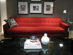 red couch and grey wall