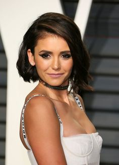 Nina Dobrev Photos Photos - Bulgarian actress Nina Dobrev poses as she arrives to the Vanity Fair Party following the 88th Academy Awards at The Wallis Annenberg Center for the Performing Arts in Beverly Hills, California, on February 26, 2017. / AFP / JEAN-BAPTISTE LACROIX - 2017 Vanity Fair Oscar Party Hosted By Graydon Carter - Arrivals