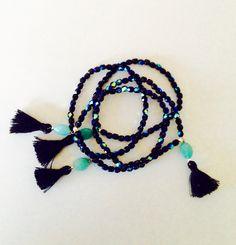Bracelet élastique perles de bohème noir jet AB, pompon noir, Pierre fine Amazonite .