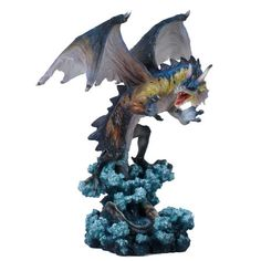 Torus, a Dragon of the Sea, standing 26cm tall (including waves) with his wings and talons outstretched ready for battle