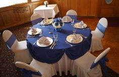 Swiss Park Package A in platinum and royal blue. Full length platinum tablecloths with royal blue pinup overlay. Silver knit chair covers with royal blue organza bows. Topped with silver plate chargers and platinum colored fan-folded napkins. Centerpiece provided by Flowers by Lorena, Chino CA Plate Chargers, Charger Plates, Centerpieces, Table Decorations, Sweet 16 Parties, Chair Covers, Tablecloths, Event Decor, Pinup