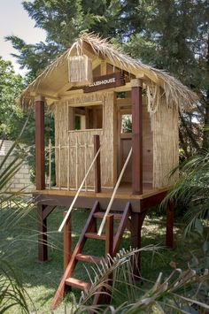 Tiki Hut! Here is my completed backyard clubhouse for the boys. Fun project.