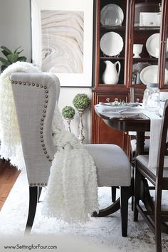 Dining Room Update - shop the look! All resources listed including these gorgeous nail head wing back chairs!