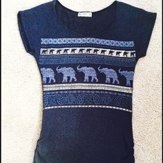 Cute Elephant Knit Top Stretchy Knit Top With Elephants Across The Front. Looks Really Cute With Leggings, Jeans, or Shorts! First Row of Elephants are On Silver Background. Larger Print Elephants in Grey!  Agenda Tops Blouses