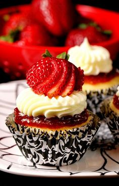 Strawberry Cheesecake Cupcake: Cheesecake filled Vanilla Cupcake with Strawberry Puree and Whipped Cream Cheese Frosting.