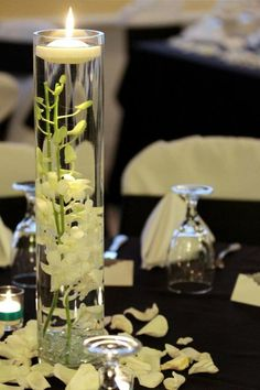 CP tables) submerged white orchids with floating candle in cylander vases - surrounded by 3 of your cylinder bowls or short square vases - all with clear crystal lined bottoms and floating candles (or) green cymbidium orchids and white & green rose petals Floating Candle Centerpieces, Orchid Centerpieces, Wedding Centerpieces, Wedding Decorations, Wedding Ideas, Wedding Tables, Wedding Reception, Table Decorations, Wedding Arrangements