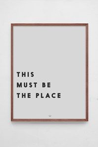 """Track Poster by Low Key with Talking Heads' """"This must be the place"""" printed in dark grey type on untreated light grey 160g paper. Frame not included."""