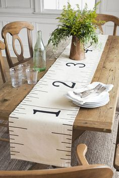 """Follow the steps below to do a number on a drab drop cloth ($10.98 for 6'W × 9'L; homedepot.com for stores). Step 1: Cut a strip from the drop cloth that measures 14¼""""W × 8'1¼""""L; press it to iron out any wrinkles. To hem all four edges: Turn each under ⅝""""; press, then stitch in place using a ½-inch seam allowance. The fabric strip should now measure 13""""W × 96""""L. Step 2: Working on one of the strip's long sides and starting at a short end, use a ruler and a pencil to measure and mark one inch…"""