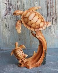 Mom and baby resin sea turtles statue looks like a wood carved dolphin figure. Dremel Wood Carving, Stone Carving, Wood Carving Patterns, Carving Designs, Sea Turtle Pictures, Wood Carving For Beginners, Baby Sea Turtles, Yard Sculptures, Engraving Art