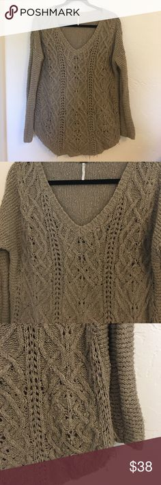 FREE PEOPLE Taupe Knit Sweater Pretty semi oversized knot sweater with fitted arms. Rounded Hem. Great for layering. Has some snagging or pulling on one sleeve- see photo. Can just be bunched up a bit to make the pulling barely noticeable. Great over a Tunic and skinny jeans for fall. Free People Sweaters