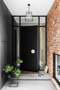 The door handle detail is on point. Loving the … Beautiful front door simplicity. The door handle detail is on point. Loving the use of Haymes Intrigue on the wall – really makes the bricks pop. Beautiful Front Doors, Black Front Doors, Black Windows, Modern Entrance, Modern Front Door, Timber Front Door, Entrance Ideas, Door Ideas, Front Door Entrance