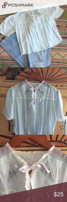"""Vintage Bed jacket 1950's Sweet vintage bed jacket or kick it with jeans.  Underarm to underarm 20.5, length 19"""", cross back top shoulder seam to seam 15.5"""" small pin hole on sleeve please see last picture. . Light baby blue, ornate triangle sheer points around collar, two sateen ribbons, two small roses pink Other"""