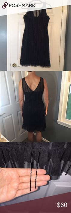 """JS Collections Black Dress Beautiful black cocktail dress.  Beautiful beading.  Dress is in beautiful condition except for a row in the back, down by the rear end.    PP 18"""" Shoulder to bottom of dress:  37.5"""" JS Collections Dresses"""
