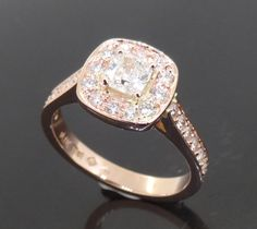 Rose-Gold-Cushion-Cut-Centre-Diamond-surrounded-by-Grain-Set-Diamonds-Halo-Style-Engagement-Ring.jpg (JPEG Image, 1247 × 1110 pixels) - Scaled (60%)