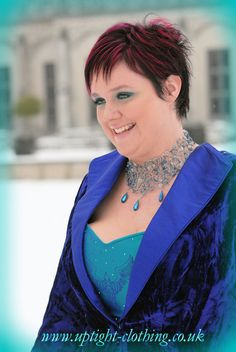 A curvaceous hourglass corset in Turquoise silk, with a embroidered bird emblem in purple , with applied Swarovski crystals. With the same full ball gown Turquoise silk skirt as Dragonfly queen, but this time finished of with a fitted and flattering purple velvet jacket with open collar. A simpler variation of some of the lovely victorian jackets that uptight have been doing over the years. Turquoise Wedding Dresses, Embroidered Bird, Velvet Jacket, Purple Velvet, Gorgeous Fabrics, Silk Skirt, Fishtail, Looking Stunning, Hourglass