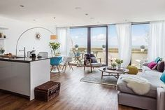 There is an open-plan living/dining/kitchen area leading to a decked terrace plus bedroom and bathroom on the ground floor. The high spec interior includes underfloor heating supplied by an air source heat pump, integrated kitchen appliances and a Sonos music system.