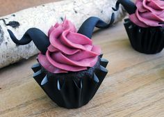 Maleficent Cupcakes. Dark chocolate blackberry cupcakes. Link to recipe.