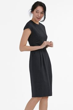 Corporate and cool are not mutually exclusive. Case in point: the Masha, which is equal parts elegant and fashion-forward. Newly updated in a wool pinstripe, this tailored silhouette combines a loose top with a nipped waist and a modern pencil skirt.