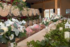 Mr & Mrs barrel, country wedding display. Table centerpieces with pink linens and white and pink-colored rose bouquets + greenery garland and white lanterns. Table Centerpieces, Wedding Centerpieces, Wedding Themes, Wedding Photos, White Lanterns, Greenery Garland, Rose Bouquet, Linens, Summer Wedding