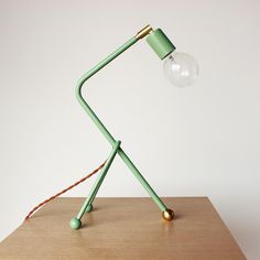 Tripod Desk Lamp by onefortythree. Lots of personality in this desk lamp. luv it.