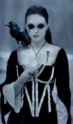 Haunting. The Birds. Eyes or just sockets? Life drained. Pale blue grey. Woman and raven.  - death's companion