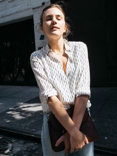 There is something so simple and easy about a silk blouse and jeans. One button unbuttoned too far, a peek of...