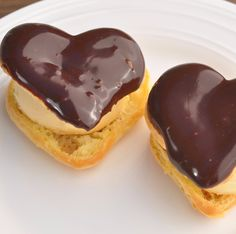 Heart Puff Pastries with Ice Cream & Chocolate Sauce - Delicate puff pastries filled with homemade ice cream (or Creme Chantilly) and dipped in chocolate ganache. Cream puffs can be made days ahead of your holiday party or special occasion. Once baked, place in freezer bags and defrost at room temperature when needed. Once defrosted place them in 400°F oven for 4 minutes to make them crisp again and you are all set to fill with crème Chantilly or homemade ice cream. Melt the hearts of those…