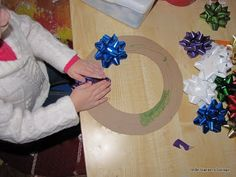 Bow Wreath! Kid friendly craft, seems simple for them. Parents, cut out the circle frame & let kids stick on bows.