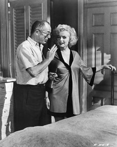 """Marilyn Monroe and Billy Wilder on the set of """"Some Like It Hot"""", 1958."""
