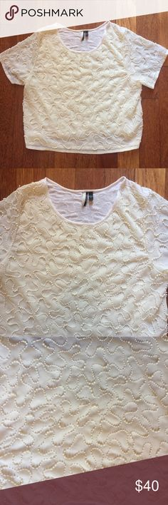 """TopShop size 10 cream beaded top short sleeve Beautiful TopShop size 10 cream beard short sleeve top. Solid cream lining with beading all over. A few missing beads on top of shoulder see photos. Not very noticeable. Measures across chest 19"""" sleeve length 10"""" length of top approx 19.5"""" poly viscose blend. From a smoke free home Topshop Tops Blouses"""