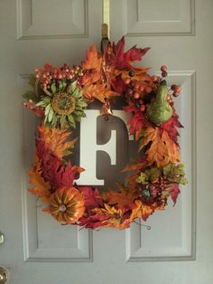 Fall wreath for front door. I used a leaf garland around a grapevine branch wreath with a few decorative pieces from hobby lobby. I also added a letter that I painted ivory with a decorative ribbon.  Got this idea from another pinner and it turned out great!!! pinterest project is a success