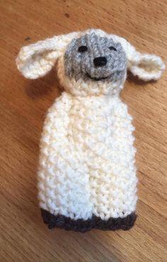 A tiny izzy-doll sheep