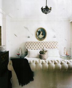 This is not just a simple white on white bedroom. bring it via a vintage portrait, black chandelier and tufted headboard. All White Bedroom, Dream Bedroom, Home Bedroom, Bedroom Decor, White Bedrooms, Master Bedroom, Design Bedroom, Bedroom Ideas, Bedroom Lamps