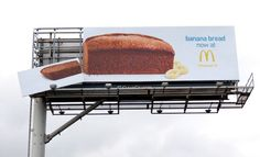 Cut me a slice. Nice use of a billboard by Arnold Worldwide for McDonald's, to herald the arrival of its new banana bread. Makes us want a slice. Mcdonalds, Out Of Home Advertising, Creative Advertising, Advertising Ideas, Advertising Agency, Street Marketing, Guerilla Marketing Examples, Funny Billboards, Billboard Design