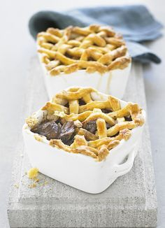 Beef cooked slowly in red wine and herbs until tender is good enough on its own, but topped with a crisp shortcrust pastry lattice, it's even better. These easy pies are smart enough to serve up for a dinner party.
