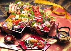 Osechi-ryōri お節料理 : : : A special meal usually served in a beautifully painted box, with traditional food items which symbolizes good luck and fortune typically served on New Year's Day.