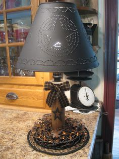 Spool Light with punched tin shade. Cute!